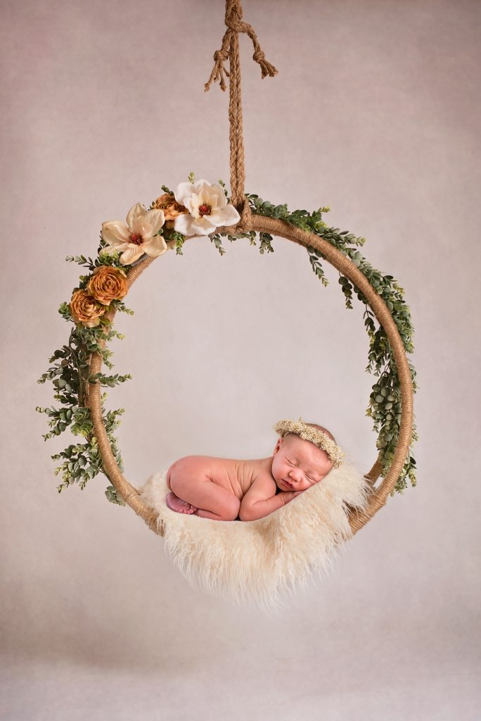 Baby in Peach and Cream Swing